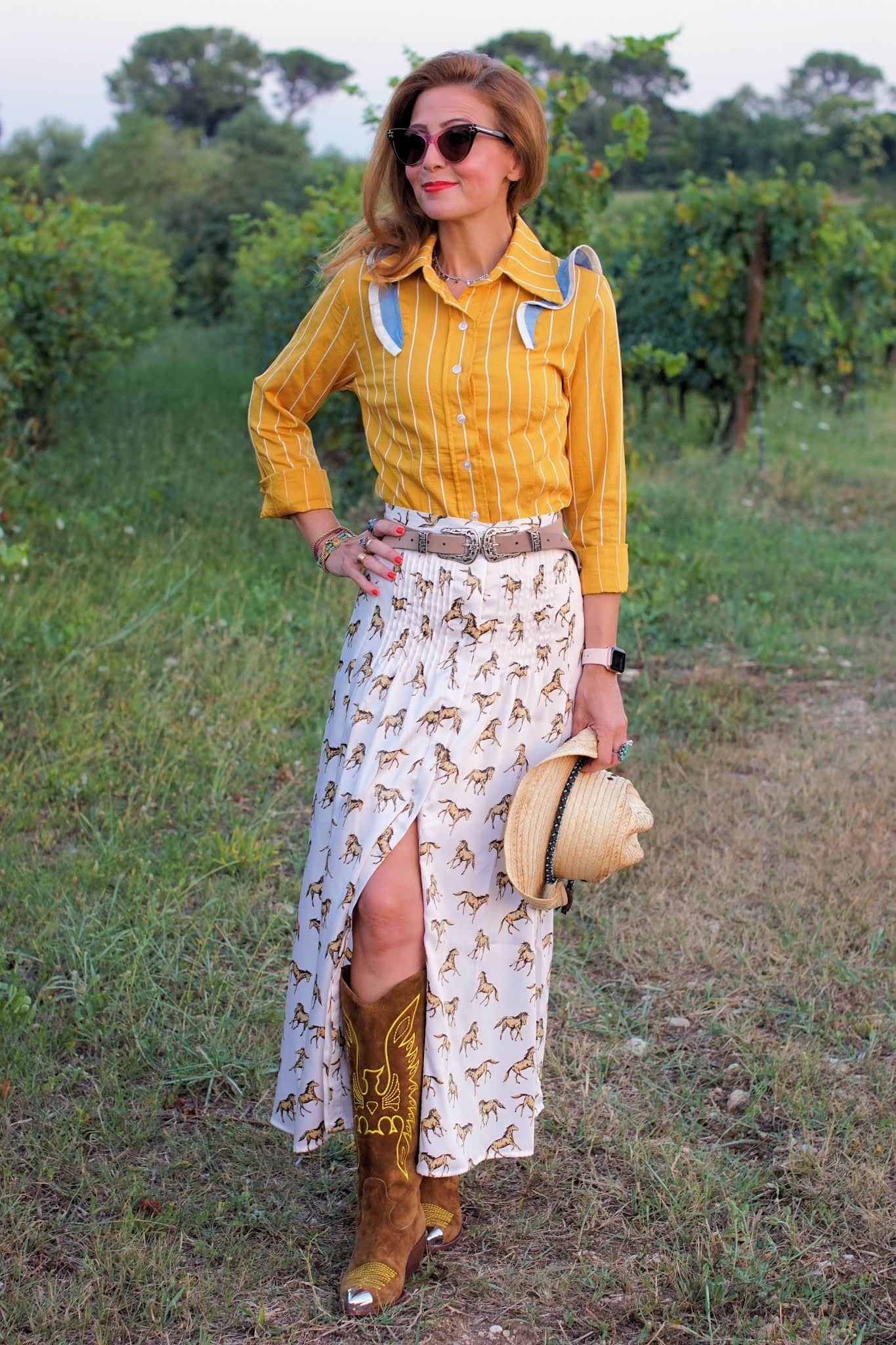 Vale from Fashion and Cookies in a yellow striped shirt and a pony print skirt