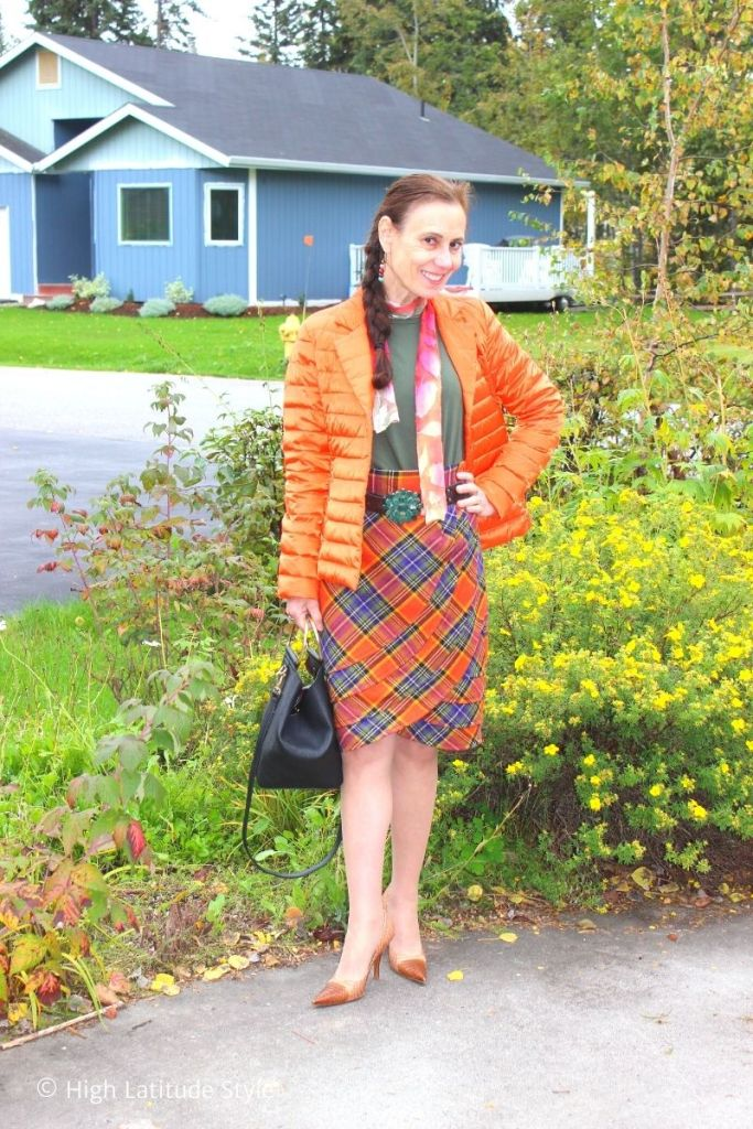 stylist in blazer, plaid draped skirt, tie-dyed scarf, pantyhose