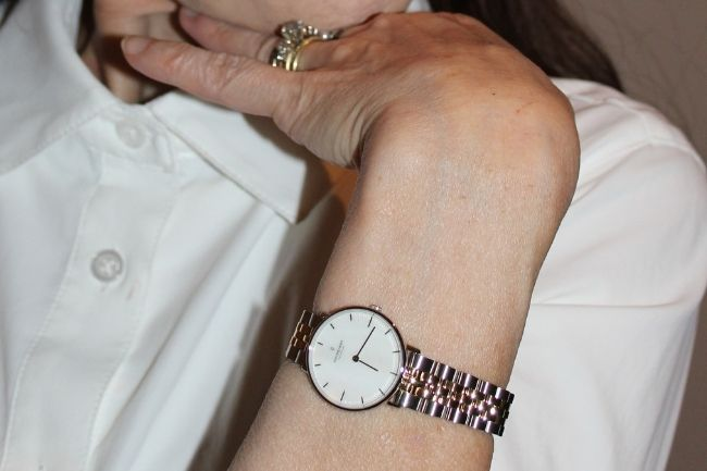 two-tone Nordgreen watch with white mother-of-pearl dial