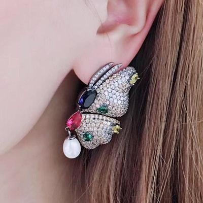 pearl drop on butterfly stud