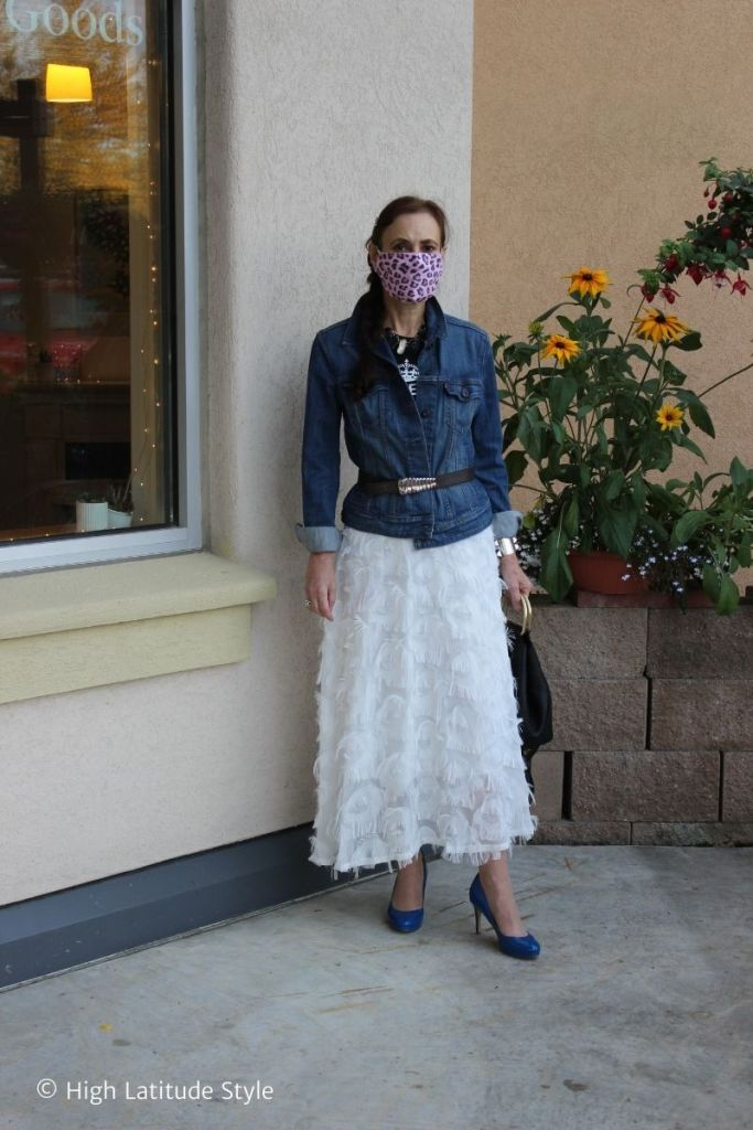 over 50 years old influencer in feather A-line skirt denim jacket