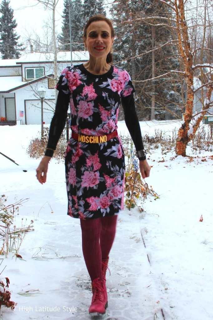 stylist in sheath dress, tights, belt, sneakers, dangling ear jewelry