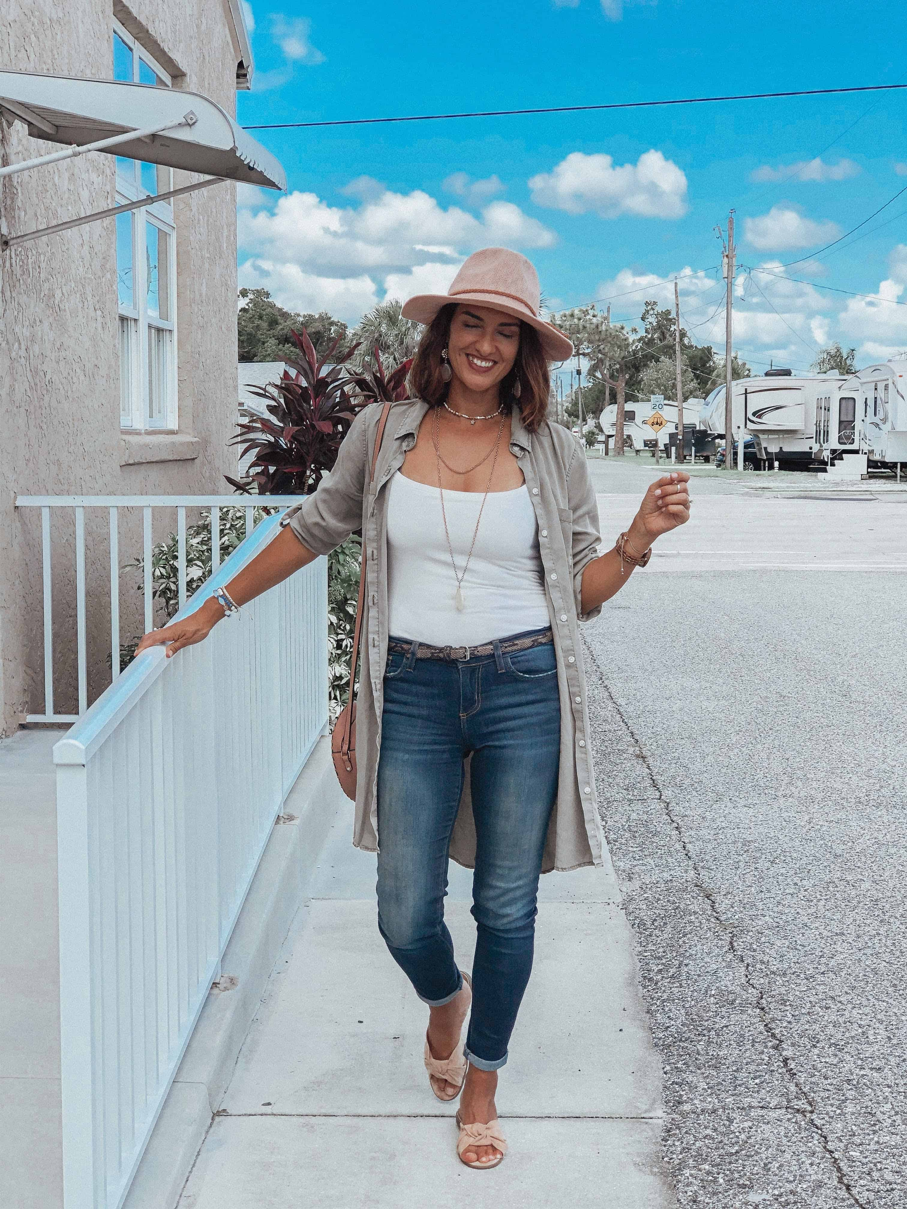 Style winner Chrissy in tanktop, shirtdress, jeans, slides and hat