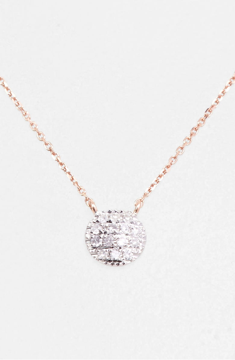 diamond disk on a gold necklace
