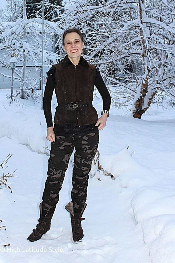 style blogger in camouflage pants in eceltic combination of sequin top and shearling vest