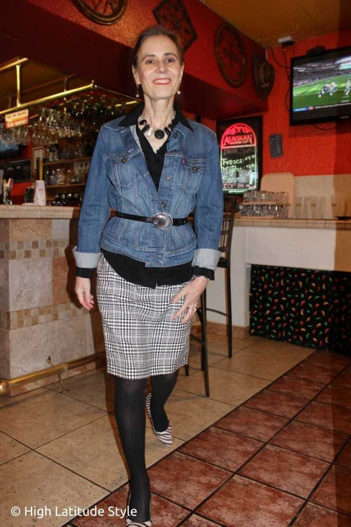 style influencer in houndstooth pencil skirt, black blouse, blue jacket, pantyhose
