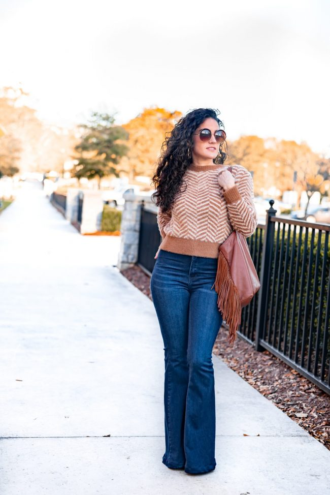 Erica Valentin in jeans and zigzag pattern sweater