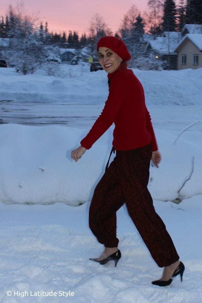 Alaskan style blogger in festive jogging pants, turtleneck sweater and beret all in red for a date inside