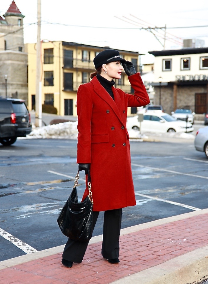 Tatiana from my fab fifties in red coat with fisherman's hat black dress pants shoes and gloves
