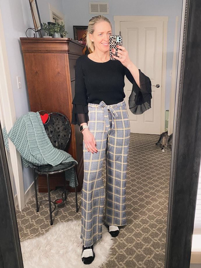 Jill in tartan pants and blank top