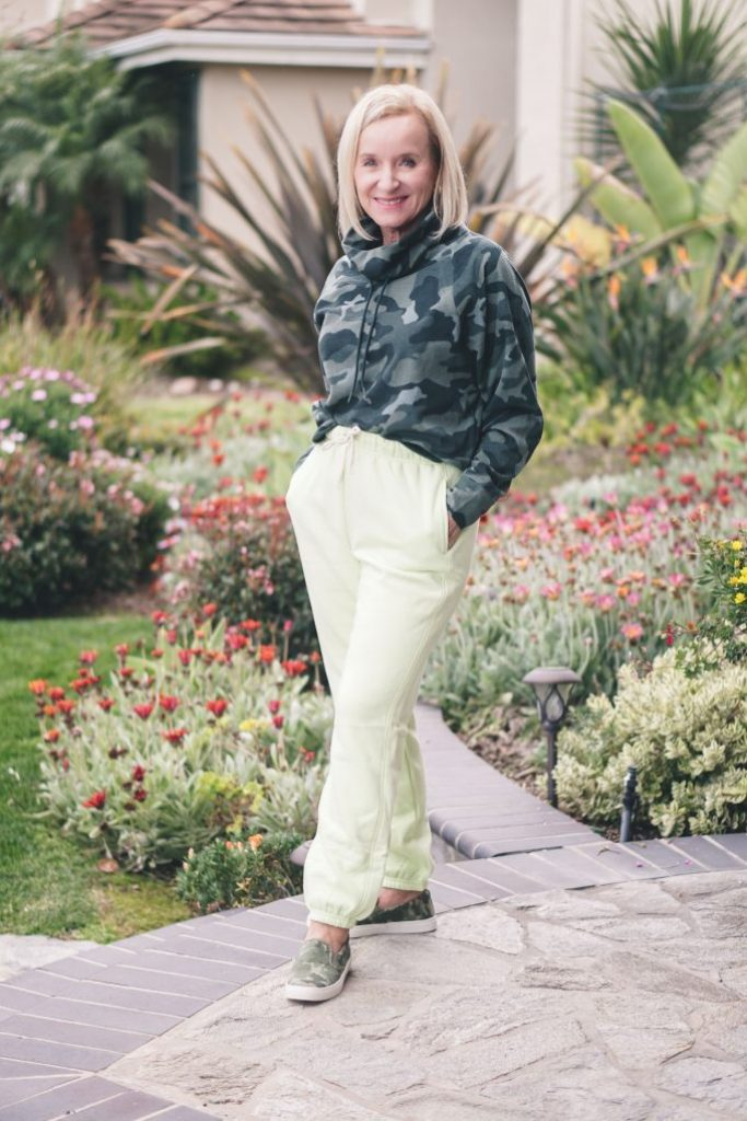 Darlene in lime joggers and camouflage hoodie
