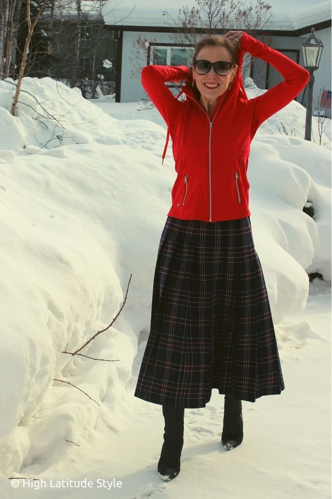 fashion blogger in midi skirt, vshred lightweight jacket, heels frolicking in snow