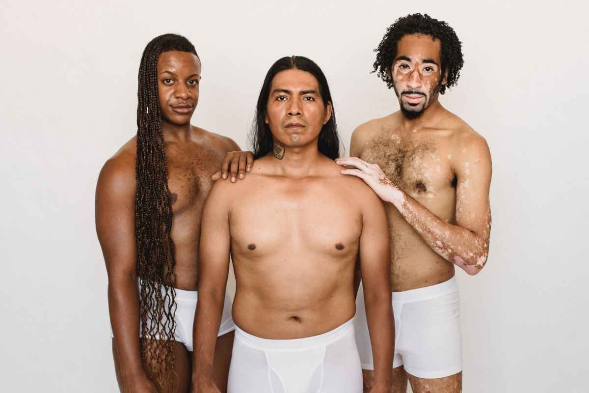 multiracial models in underwear on white background