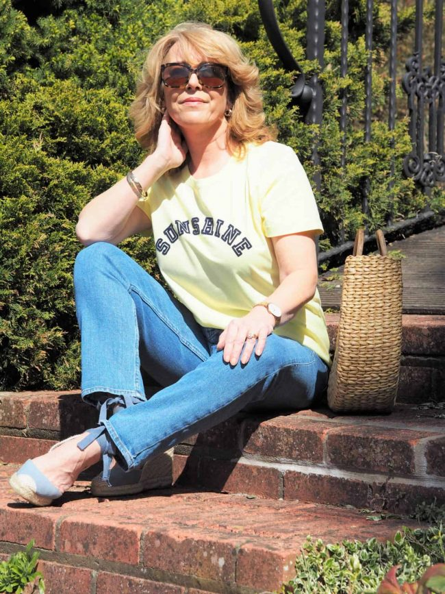 Debbie of Vanity and Me in jeans, T-shirt, espadrilles and sunglasses