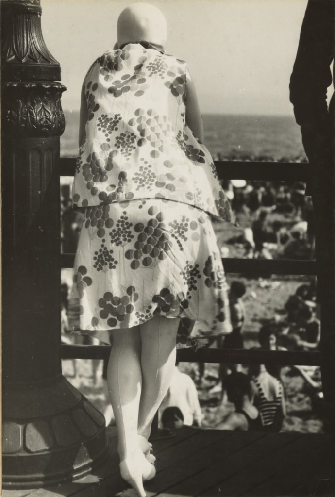 photo of a young woman with abstract cherry patterned two piece ensembe and hat