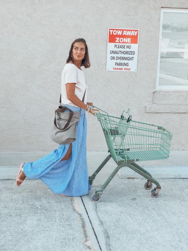Style winner Chrissie in maxi denim skirt, white Tee with shopping chart