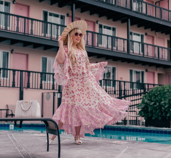Lizzie in a romantic dress at the pool of a Motel