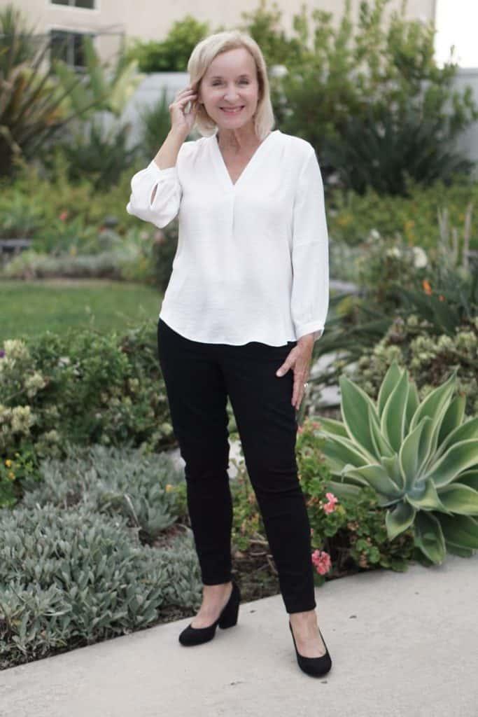 Darlene in white blouse black pants