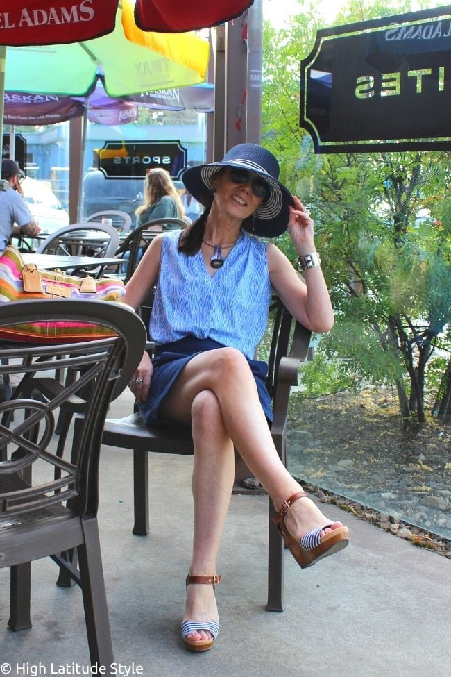 stylist in sunsafe skorts, blouse, hat, comfy plateau sandals