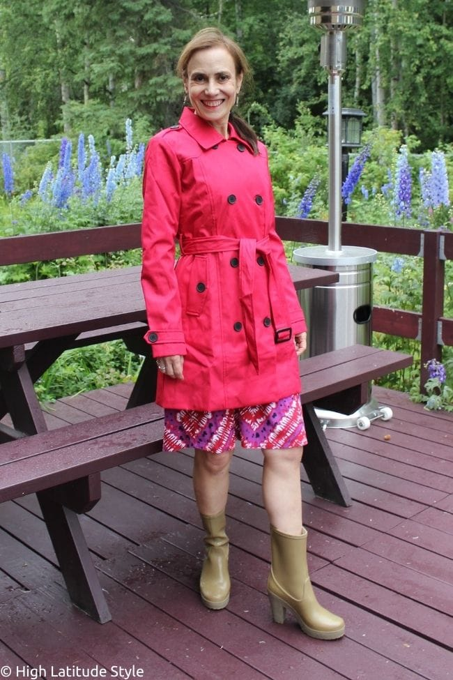 red military inspired belted rain coat over print dress with rainboots