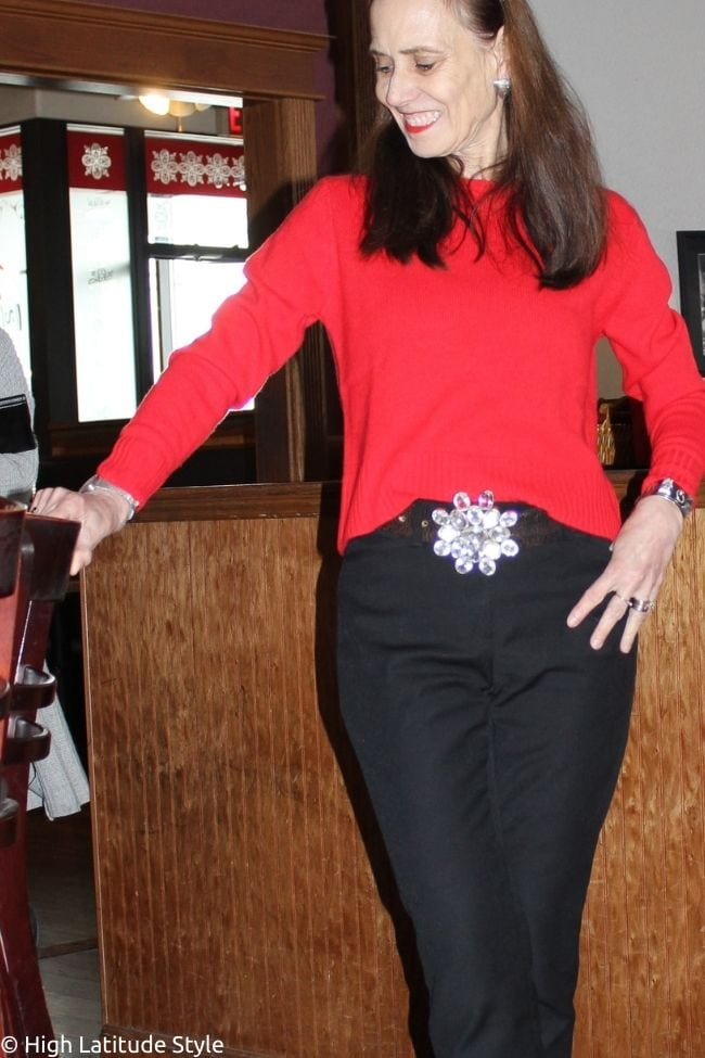 stylist in Italic cropped red sweater with black cropped pants, heels