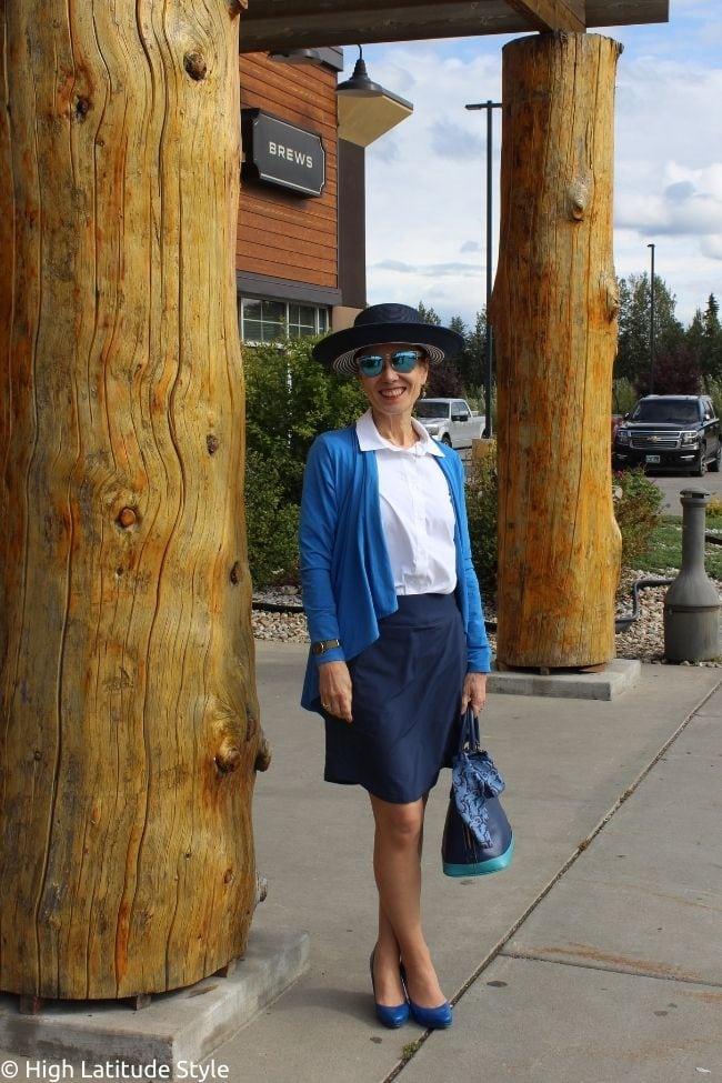 environmental scientist in white button down shirt, skorts, heels and cardigan