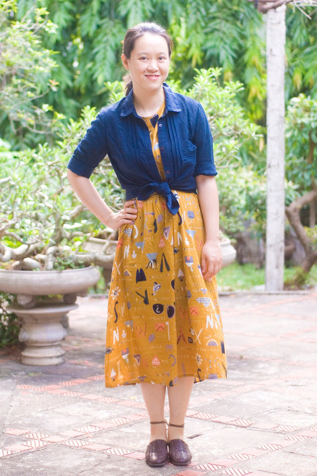 Salazar in yellow print dress with blue knotted top fall trend