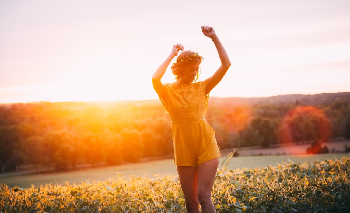 A highly sensitive person dances in a field.