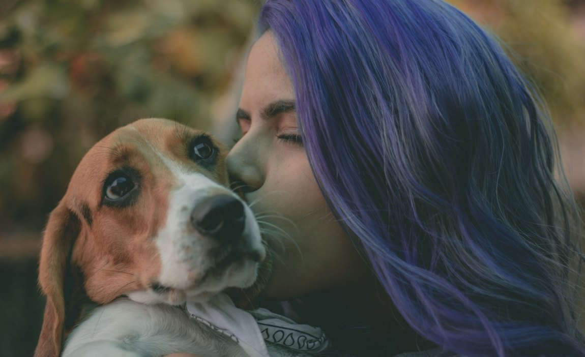 a highly sensitive person kisses her dog