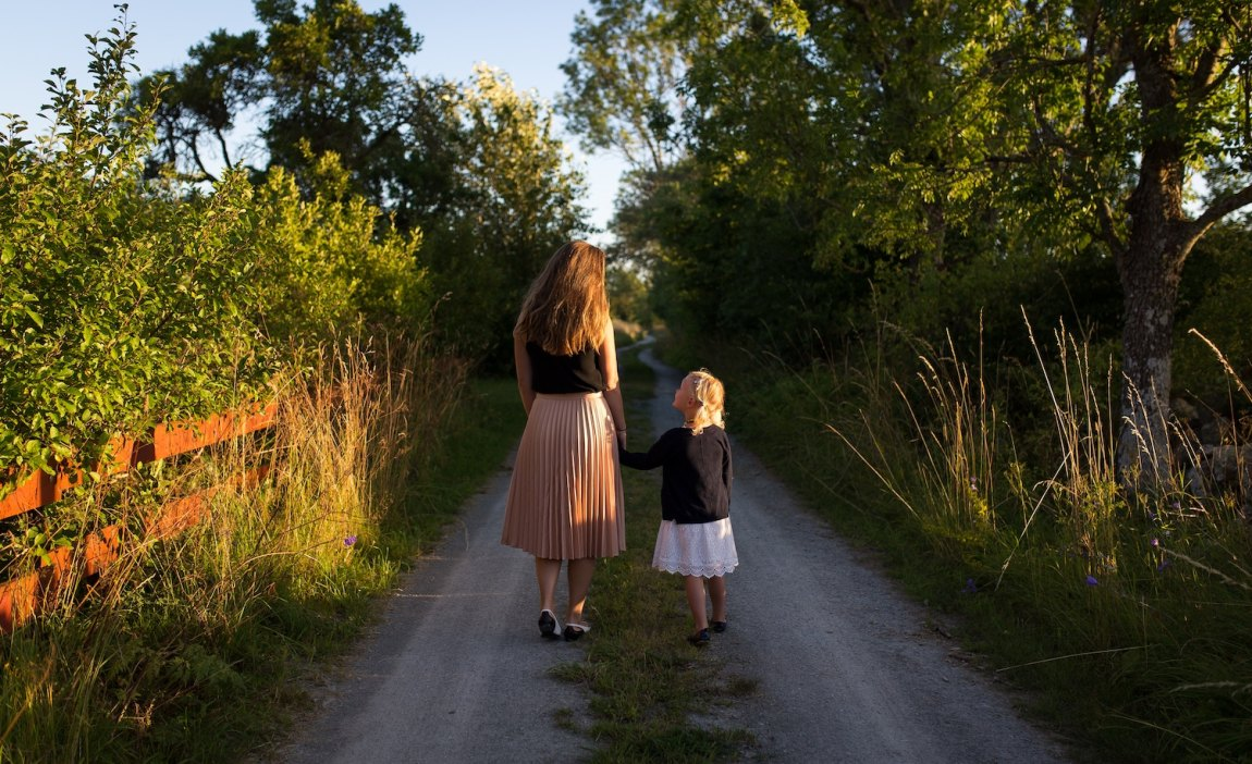 a highly sensitive parent and child walk down a road together