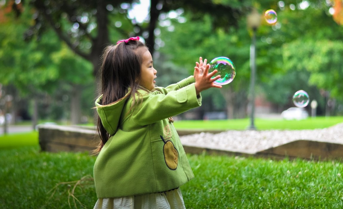 a highly sensitive child catches bubbles