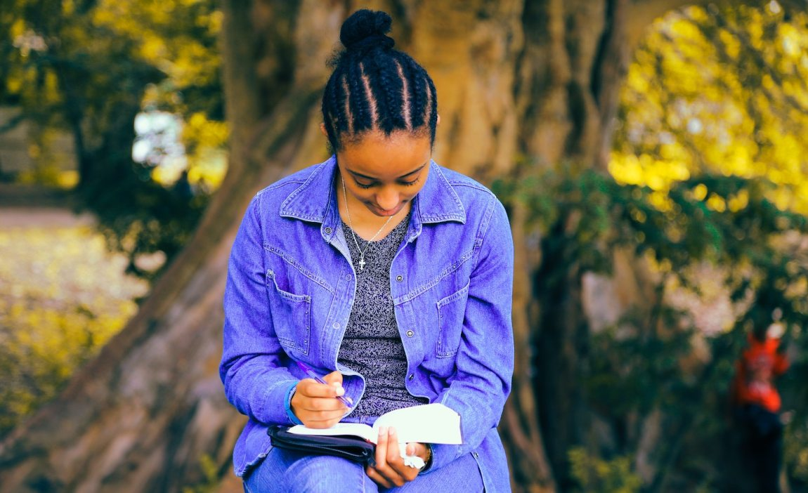 A highly sensitive person (woman) writes in her journal to get through a difficult time