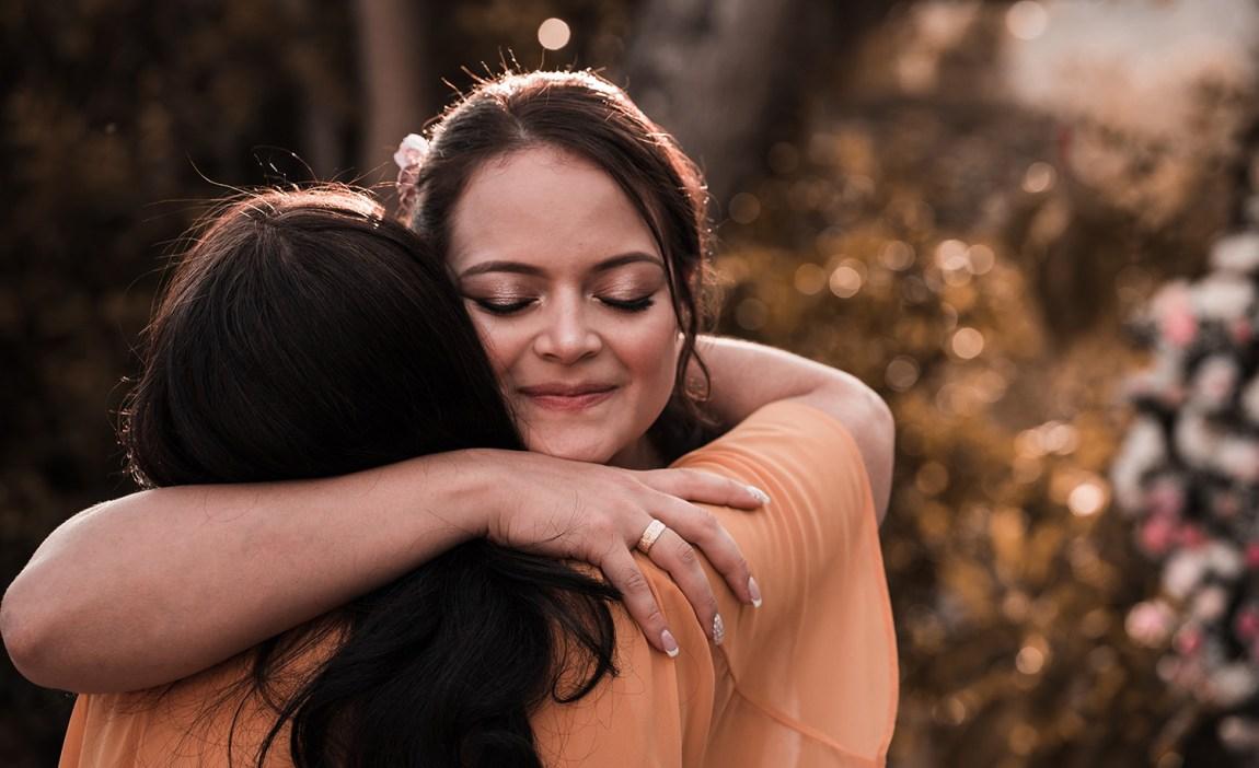 A highly sensitive person hugs a friend