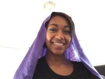 Long, rectangular, purple scarf draped over head.