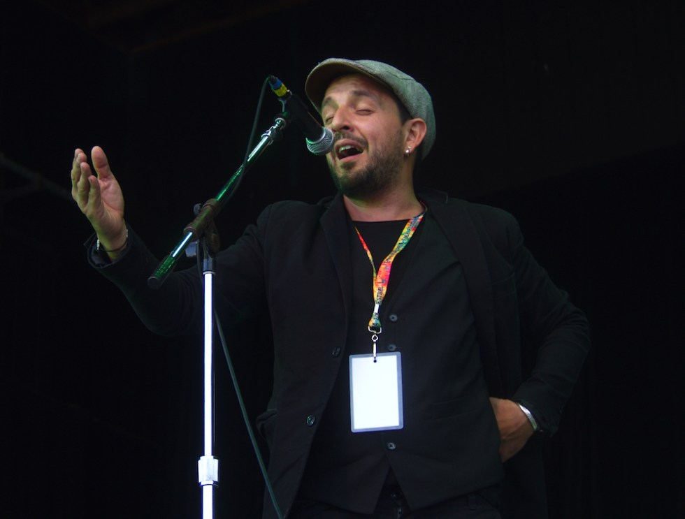 Andres Martorell of Baile An Salsa sings on the Martin Guitar Main Stage Sunday evening at the 56th annual Philadelphia Folk Festival (The High Note/ Shaun R. Smith).