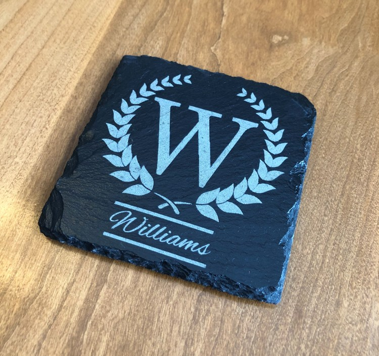 Angled view of monogrammed slate coasters