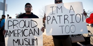 Sharjeel Hassan, left, and Yusuf  Alwar,, both of Richardson, Texas, holds signs as they stand with supporters outside the Curtis Culwell Center, Saturday, Jan. 17, 2015, in Garland, Texas. A muslim conference against terror and hate was scheduled at the event center. (AP Photo/Tony Gutierrez)