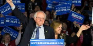 Democratic presidential candidate, Sen. Bernie Sanders, I-Vt,  and his wave Jane acknowledge the crowd as he arrives for his caucus night rally in Des Moines, Iowa, Monday, Feb. 2, 2016.  (AP Photo/Patrick Semansky)