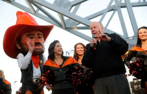 Oklahoma State alum T. Boone Pickens, Jr. fires up the Cowboy fan base during a tailgate party on the East Plaza of AT&T Stadium before the Cotton Bowl game against Missouri, Friday, January 3, 2014 in Arlington, Texas. (Tom Fox/The Dallas Morning News) 01042014xSPORTS
