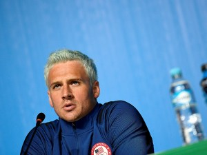 US swimmer Ryan Lochte holds a press conference on August 3, 2016 in Rio de Janeiro, two days ahead of the opening ceremony of the Rio 2016 Olympic Games. / AFP / Martin BUREAU        (Photo credit should read MARTIN BUREAU/AFP/Getty Images)