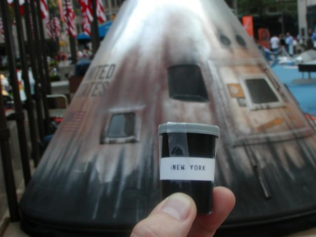 """Could he get some more rocks for his collection? Who's taking him to the moon? This is actually a model of the command module that was used in the """"Apollo 13"""" movie. It was part of the Centennial of Flight exhibit in New York's Rockefeller Center."""