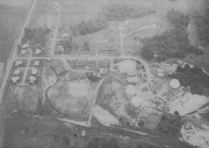 "Aerial view of Campbell Hill Showing radar installations: The 664th AC&W Squadron circa 1954. The highpoint is located between the radar stations and the softball field. The author played on a much improved version of the softball field in the early 1970's. The field, which no longer exists, was a favorite among the local softball players, not because of the ""thinner"" air but because of the prevailing winds over the highpoint ridge."