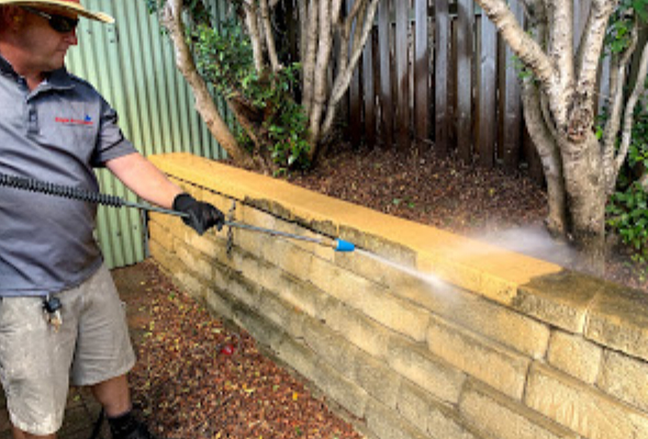 Pressure Cleaning a Sandstone Retaining Wall