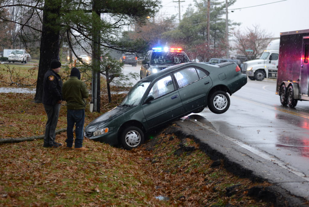 car in ditch along Union Cemetery Road