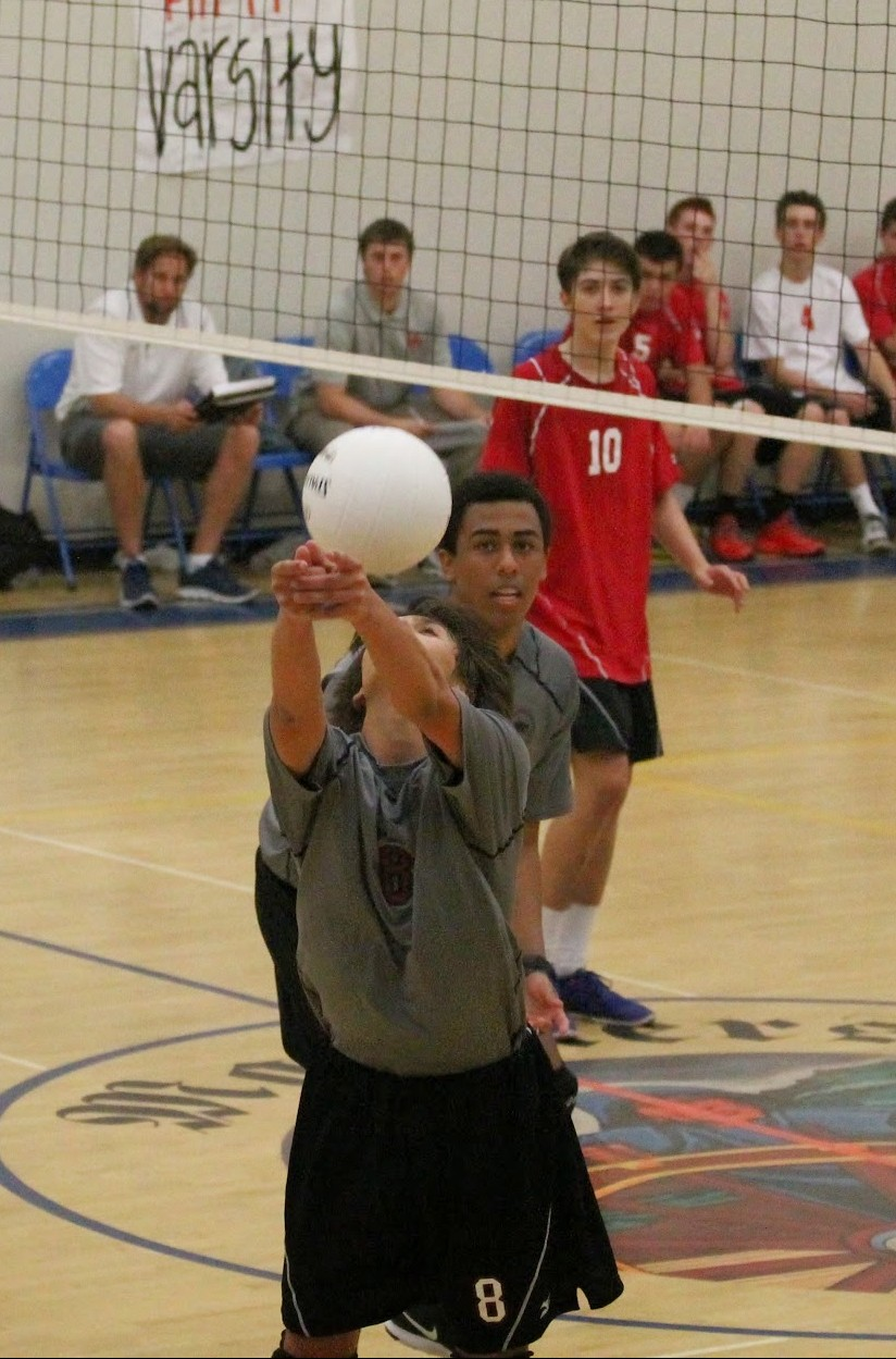 Freshman Kyle Cobain bumps the ball from behind while senior Aaron Hook anticipates the hit. Credit: Sarah Kagan/The Foothill Dragon Press