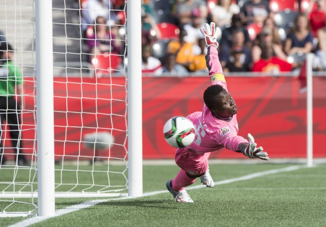 TOPSHOTS Ivory Coast goalkeeper Dominique Thiamale fails to stop Germany's Alexandra Popp's free-kick during their 10-0 demolition of the African first-timers in a Group B match at the 2015 FIFA Women's World Cup at Landsdowne Stadium in Ottawa on June 7, 2015.    AFP PHOTO/NICHOLAS KAMMNICHOLAS KAMM/AFP/Getty Images ** OUTS - ELSENT, FPG - OUTS * NM, PH, VA if sourced by CT, LA or MoD **