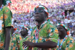 A member of Team Cote D'Ivoire peers off into the crowd of supportive fans during the Special Olympics World Games Opening Ceremony on Saturday.