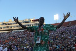 An athlete embraces the warm welcome from the fans by reaching out to the world around him during the Special Olympics World Games Opening Ceremony on Saturday.