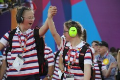 Two athletes from Norway walk hand-in-hand into the stadium during the Special Olympics World Games Opening Ceremony on Saturday.
