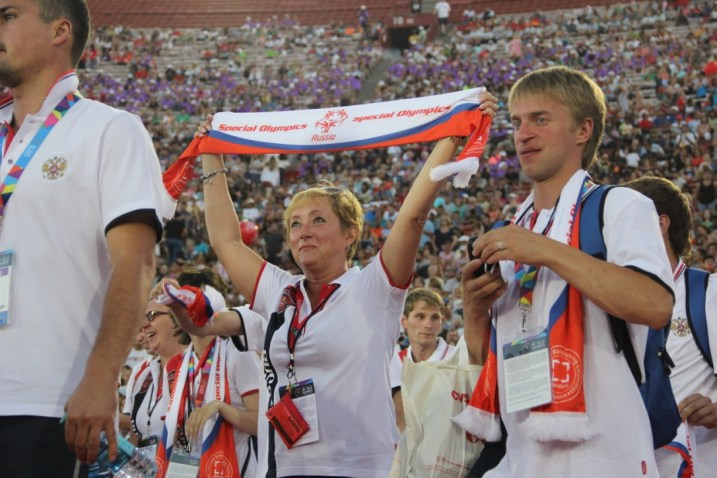A Russian coach marches in with honor for her country during the Special Olympics World Games Opening Ceremony on Saturday.
